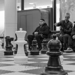 Photo: Edwin MullerStreet photography, spectators to a game of giant chess
