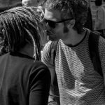 Photo: Edwin Muller Street photography, two people kissing in the street.