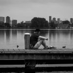 Photo: Edwin Muller Street photography, man alone in thoughts with city of Rotterdam in background